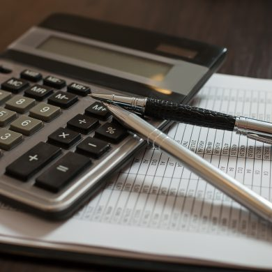 Accounting documents, pens and calculator on the table closeup